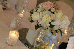 Classically Elegant Spring Wedding The Top table was probably one of the longest I've ever seen, we'd dressed it with a collection of vintage crystal vessels each one filled with posies of fresh fragrant blooms and candlesticks and floating candles