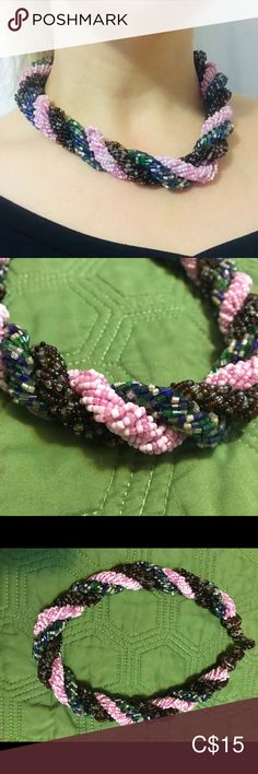 Handcrafted beaded necklace This artisan beaded necklace has sections of pink, blue/green, and brown beading. Sits close to neck. Worn once.