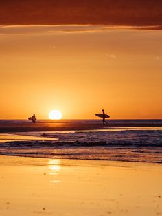 Surfers walking on the beach during sunset in Tamarindo Costa Rica. Surf art pictures photographed by Kristen M. Brown, Samba to the Sea for The Sunset Shop. Costa Rica...