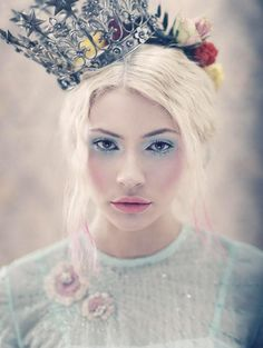 She is beautiful but I don't understand why she looks so sad, she is wearing a freaking crown! I think I need a crown.