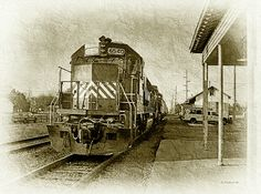 A sepia toned image of the 6540 Train arriving at the Harrington Yard Office in Harrington, Delaware.