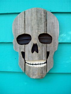 Skull made of recycled wood and plastic, upcycled fence wood. $34.00, via Etsy.