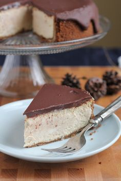 Cinnamon Eggnog Cheesecake with a gingersnap cookie crust! With hints of cinnamon, eggnog and gingerbread in each bite, you're going to love this cheesecake!