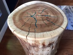 The cracks in this stump have been filled with turqouise and resin. Could do the same with a metallic color.