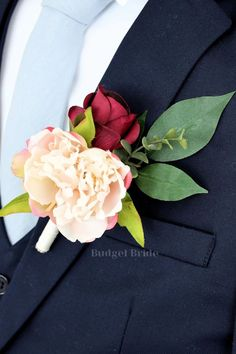 Beautiful mens lapel flowers with mauve, blush pink, rose gold, burgundy and wine roses, peonies and cherry blossoms accented with seeded eucalyptus Red Wedding Flowers, Wedding Flower Arrangements, Boho Wedding, Wedding Day, Boutonnieres, Raspberry Wedding, Budget Bride, Lapel Flower