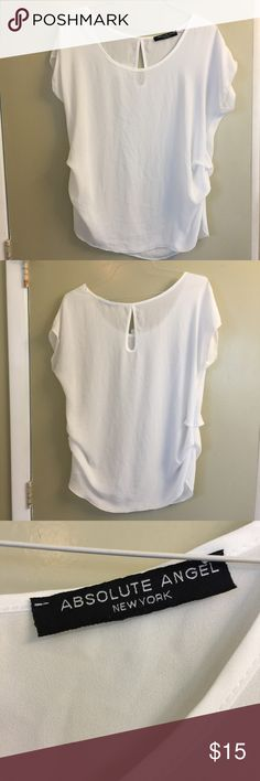 True white Absolute Angel short sleeve top True white Absolute Angel short sleeve top fits size 12-14. Missing fabric and size tag but feels like a synthetic material like rayon or polyester. Looks great as it has no stains or tears. Hard to find a white top without any blemish 😉. Absolute Angel Tops Blouses