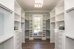 Closet with Kendall Flat Panel Cabinetry, Window seat, Hardwood floors, Crown molding, flush light, High ceiling