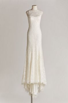 Chic, Sophisticated Wedding Dresses for Romantics: So dreamy is the soft, subtly sequined Chantilly lace from the top of the Devin gown's high-neck silhouette, down the unlined back, to the flared mermaid skirt. Details like a scalloped hemline, lightly beaded neck, and button back add to the sophisticated charm.