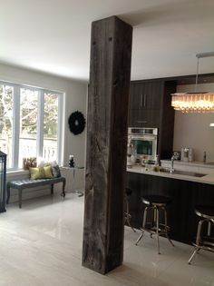 Uses for Barn Boards | Barn board used to cover support beam in kitchen | For the Home!