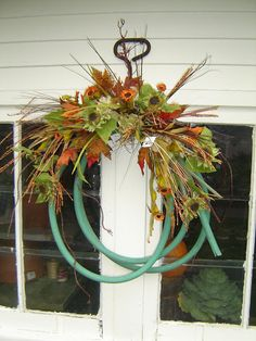 Outdoor fireplace with pumpkins Garden Hose made into a wreath. Garden Hose Wreath, Pumpkin Garden, Seasonal Decor, Holiday Decorations, Garden Junk, Summer Wreath, Autumn Inspiration, Outdoor Spaces, Projects To Try