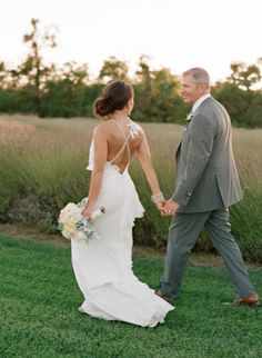 Stunning low-back gown: http://www.stylemepretty.com/2015/02/09/colorful-fall-bear-flag-farm-wedding/   Photography: Elizabeth Messina - https://instagram.com/elizabethmessina/
