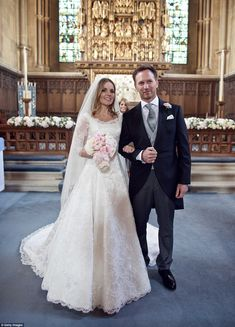 Man and wife: Geri Halliwell and her new husbandChristian Horner have released official images from their traditional church wedding heldin Woburn, Bedfordshire on Friday
