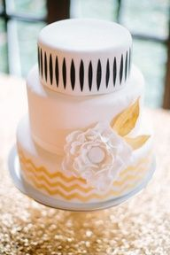 2013 Wedding Trends | Black Details - White, black, gold wedding cake | cake design by http://www.cakecouturecleveland.com/ | photography by http://www.ariellephoto.com/