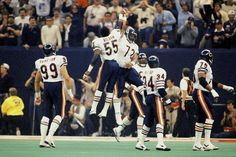 """William """"The Refrigerator"""" Perry and Otis Wilson celebrate as the Chicago Bears win Super Bowl XX, against New England Patriots on Jan. 1986 at the Superdome in New Orleans. """"The Fridge,"""" who received history's largest Super Bowl ring (size. Cincinnati Bengals, Indianapolis Colts, Nfl Cheerleaders, Cheerleading, 1985 Chicago Bears, William Perry, Nfl Houston Texans, Otis Wilson, Bear Photos"""