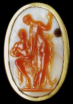 Ring adorned with a cameo depicting a satyr and nymph.  Gold, carnelian, onyx.  Approx.  50 BC - 20 CE.  Weight 10.08 g, with a cameo 3,25 × 2,27 cm. Berlin State Museums, Old Museum.