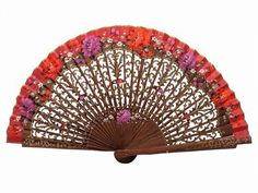 Spanish handmade fans are synonymous with creativity and quality. That is why we propose you this bubinga wood fan, fretwork and decorated in gold. It also has beautiful flowers painted on one of its faces. It is a perfect fan to carry it in your handbag. Measures: 35cm X 18.5cm