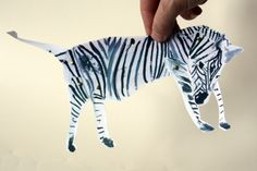 Zebra Doll - Articulated paper doll Kit. - Make paper dolls out of us with a a few pages of scenery from places we have been in the book