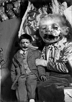 I am not entirely sure what's happening in this image with a really creepy ventriloquist doll.