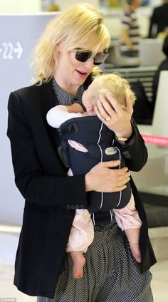 Airport attire: Cate wore a polished black blazer and black sunglasses while her daughter ...