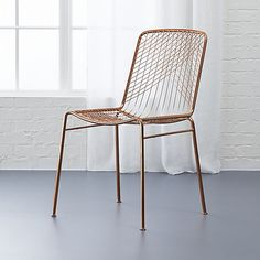 cb2 beta rose chair. doesn't look comfortable, but it's pretty.