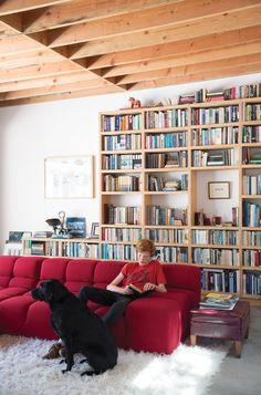 Wes Mahony lounges on a Tufty-Time sofa by Patricia Urquiola for B&B Italia in the family room that architect Emily Jagoda created for his family in their tree-damaged garage in Santa Monica.