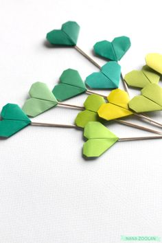 12 Origami Cupcake Toppers / St. Patrick's Day / by NANAZOOLAN, $8.00  #st #patricks #day #green #clover #clovers #leaf #party #food #picks #spring #hearts #origami