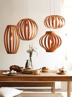 Make a statement in your kitchen or dining room with a bentwood pendant light fixture. The smooth acorn finish is modern yet rustic, and the slatted fixture casts a warm, shadowy glow.