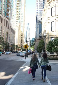 {a blonde and a brunette} ummm Morgan;).........One day this will be you and I in our city babe!