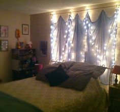 Curtains over fairy lights are perfect for the bedroom!  DIY : just hemmed a piece of fabric and strung the lights on the curtain rod - easy!!!