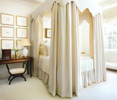 """Bedroom Bliss. Layers of fabrics, right down to the monogrammed bed linens, create a dreamy cocoon of a canopy bed that makes guests feel completely at home. """"A bedroom is very important to your well-being and peace of mind,"""" says the decorator—a concept immediately noticeable in this divinely welcoming space. Interior Designer: Phoebe Howard."""