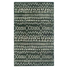 Wool rug with an abstract design in gray tones. Hand-tufted in India.  Product: RugConstruction Material: 100% Wool