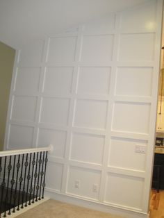 blank wall moulding on drywall and painted.. the stair railing for me!