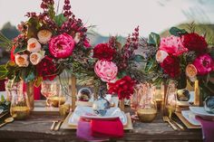 Why stick to single shades of red and pink when you can have them all? This luxurious tablescape features cranberry, fuchsia, blush, and wine in the napkins and in the lush flowers. When paired with gold it makes a truly elegant statement.