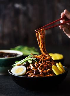 Korean Black Bean Noodles     A savory black bean sauce loaded with seared pork belly & vegetables over soft, chewy noodles.