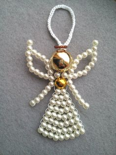 White pendant hand made beaded angel with wings and golden accents. Beautiful hand-beaded angel created with acrylic and seed beads (skirts, wings - white, waist and head - golden, Halo - brown) and strong white colored copper wire ( so it will not hang out at a time and will be