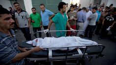 600 deaths in Israeli Gaza op: Military hits mosques, stadium, homes, hospital: Palestinians push a stretcher carrying the body of a member of the al-Qasas family who was killed in an Israeli army shelling on July 21, 20...
