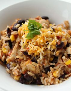 Chicken Taco and Rice Skillet Dinner Recipe: Just pour everything in, bring it to a boil...simmer for twenty minutes and you have a healthy delicious dinner the whole family will love. ~ http://reallifedinner.com