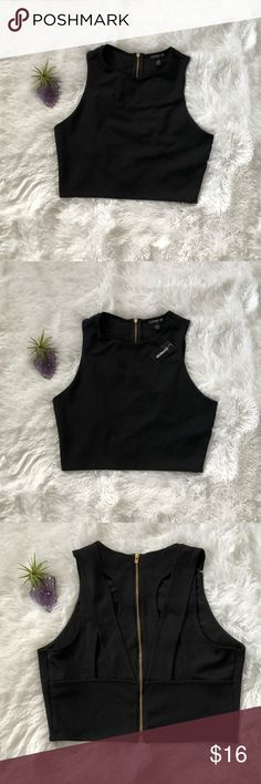 46f93885584a4 Express Top - NWT Black Express Top - NWT - Cropped with cut outs in back