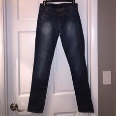 HUDSON JEANS Great pair of Hudson Jeans. Darker wash with a little distressing on front pockets. The button is missing on the back right. Inseam 31 inches. Rise 7 inches. Waist approximately 29. Size 27 Hudson Jeans Jeans Straight Leg
