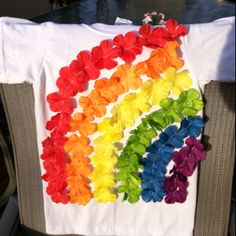 100th day of school tshirt!  My girl likes her rainbows!  Just took apart 3 leis, glued 100 (then ended up sewing) the flowers to the shirt.