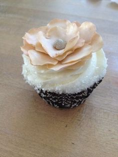 Pretty! (wedding cupcake).  Red velvet with buttercream and a black flower served in a crystal dish ...