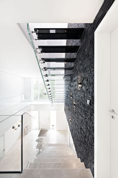 Amazing floating design stair. Stair is in all glass with black treads http://www.stairs-siller.com