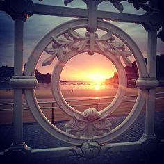 Framed summer sunset in #SanSebastian. Recharge your energy in the #PaisVasco #Spain #visitspain | Photo by @bec.lam