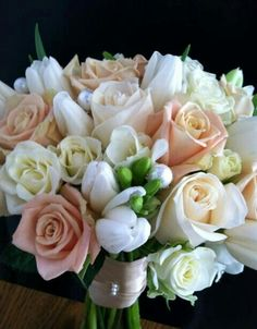 White Freesia, White Tulips, Ivory Spray Roses, Cream Roses, Sandy Peach Colored Roses Wedding Bouquet