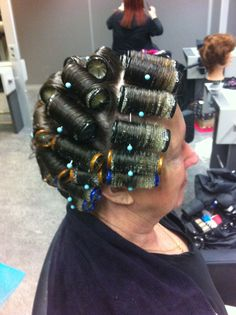 an older man who mocked his wife in curlers looks  just charming when she gets him in her salon for his first roller set-he's not laughing now