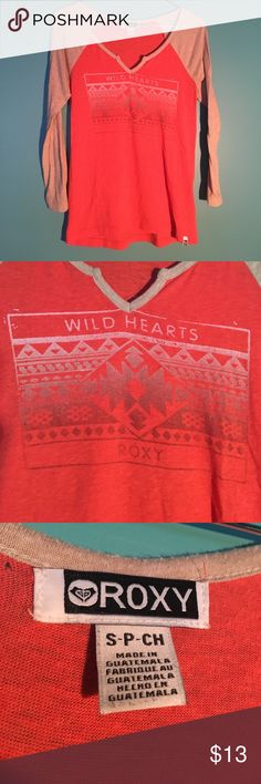 """Roxy """"Wild Hearts"""" Graphic 3/4 Sleeve Top Soft 3/4 Sleeve coral & cream colored Roxy tee. Cute tribal graphic on front. Can very easily be dressed up or down - good for many occasions Roxy Tops Tees - Long Sleeve"""