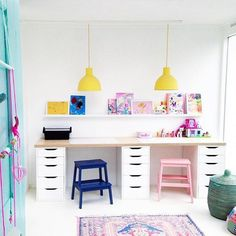 "– I love everything about your shared kids playroom/desk space! The painted stools are awesome, the happy yellow lights are…"" Desk for playroom crafting and creating -"