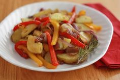 Potatoes Peperonata. Another Italian classic from one of my favorite cook books, Red, White, and Greens by Faith Willinger. Serve with grilled or pan-fried Italian sausages and rice.  http://www.culinate.com/recipes/collections/Contributors/katherine_deumling/peperonata_with_potatoes