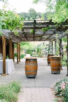 Garden wedding cocktail hour idea - pergola + wine barrel tables {Megan Clouse Photography}