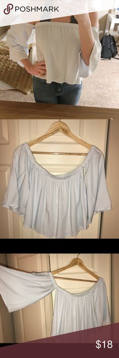 Off the Shoulder top Off the shoulder light/powder blue top. Note: this shirt was purchased in a Brandy Melville store in Austria so that is why the tag looks different! Brandy Melville Tops Blouses